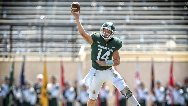 Michigan State Spartans quarterback Brian Lewerke (14) scrambles out of the pocket during the first half of a game against the Bowling Green Falcons at Spartan Stadium.
