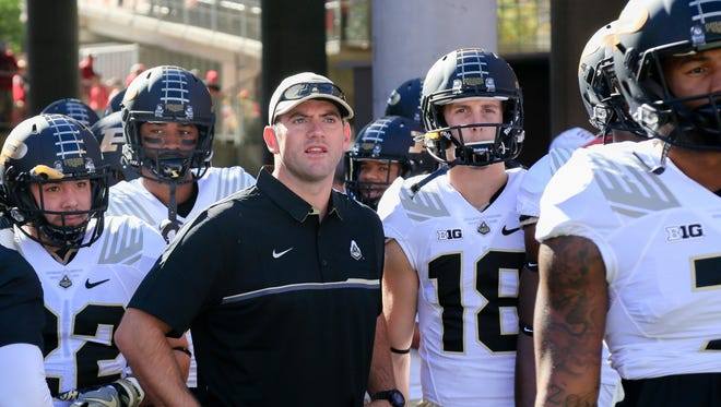 Purdue interim head coach Gerad Parker, center, stands with players during warms up before an NCAA college football game against Nebraska in Lincoln, Neb., Saturday, Oct. 22, 2016. (AP Photo/Nati Harnik)