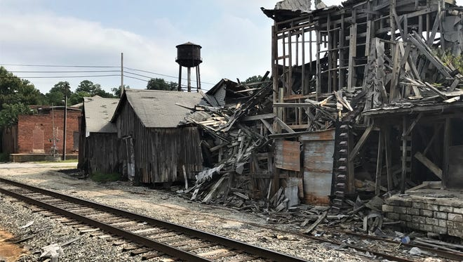 Crumbling buildings remain on the 6-acre Pendleton Oil Mill property on East Main Street two years after town officials first approached owner John Sitton about clearing the site.