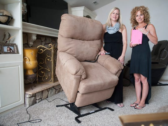 Danielle Stuffo, right, and Danielle Koenig, both of Mount Laurel, stand by a chair that Koenig purchased and that the pair loans out to women who have had or will have breast cancer surgery. The chair has a remote, which lifts the patients to a standing position and also goes back down when they need to be seated or need to lay down.