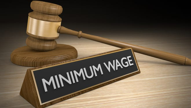 3D render of a wooden court gavel next to a sign that says minimum wage.