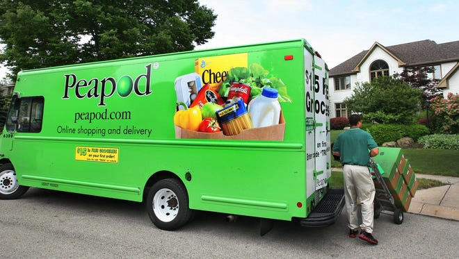 A Peapod employee delivers groceries in Indiana. The company is ending service to Wisconsin, Illinois and Indiana.