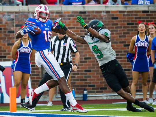 SMU wide receiver Courtland Sutton (16) catches a pass ahead of North Texas defensive back Nate Brooks (9) just before he falls to the end zone for a touchdown during the second quarter of an NCAA college football game, Saturday, Sept. 9, 2017 at SMU's Ford Stadium in Dallas. (Ashley Landis/The Dallas Morning News via AP)