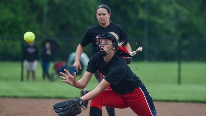 Cardington's Paige Clinger fields a pop fly during the Cardington-Coldwater regional semifinal softball game in Findlay. The Pirates won and played in the state tournament for the first time ever last spring.