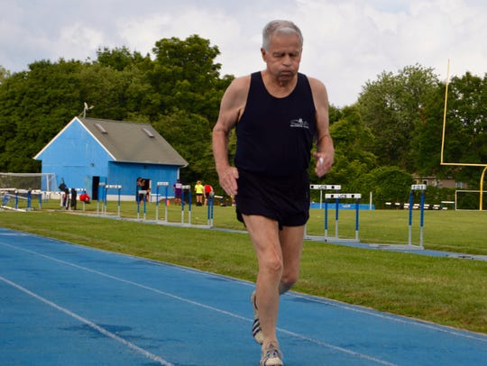 Tom Talbott, 83, sprints down the home stretch of his