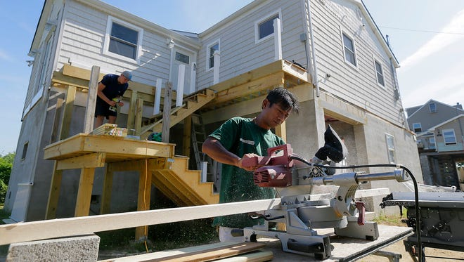 Harry Pangemanan, an undocumented immigrant from Indonesia who is helping rebuild Sandy homes on the Shore, works on a home with volunteers from Community Christian Reformed Church in Kitchener, Ontario on Cedar Avenue in the Leonardo section of Middletown, NJ Friday August 19, 2016.