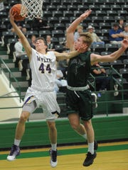 Wylie's Kyler Christian (44) drives to the basket while