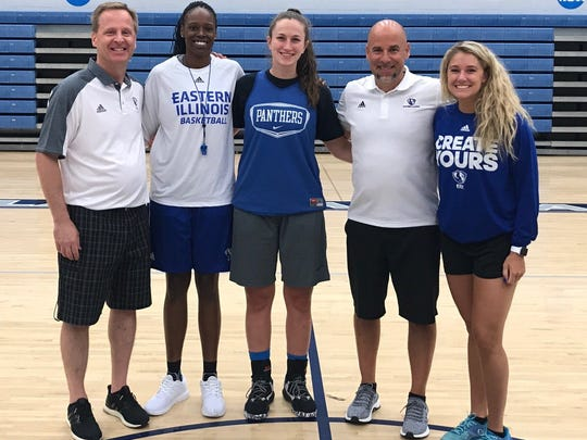Abby Wahl (middle) poses with the Eastern Illinois coaching staff. The Heritage Hills senior verbally committed to play at EIU.