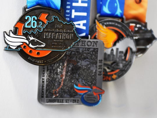 Kentucky Derby Festival finishers race medals from past years.
