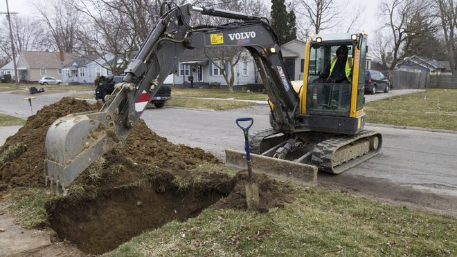 In a March 10, 2017, photo, work continues on the water replacement lines in Flint, Mich. Gov. Rick Snyder wants water customers across Michigan to pay a $5 annual fee to help upgrade aging infrastructure and replace lead pipes in their local communities.