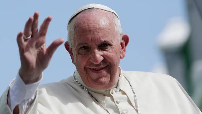 Pope Francis waves from his popemobile in Santiago de Cuba, Cuba,