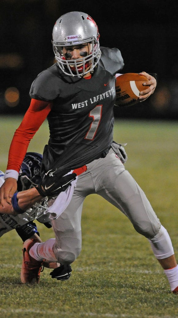 West Side quarterback Mikey Kidwell scrambles for yardage