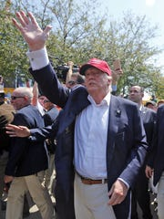 Donald Trump greets fairgoers during a visit to the
