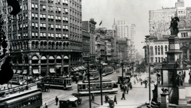 The beginning of Michigan Avenue at Woodward Avenue in Detroit, circa 1923.