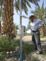 Moshe Kirat, an Israeli date grower, discusses some of the water-saving technology he uses in Thermal.
