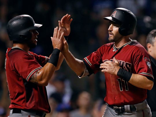 Diamondbacks A.J. Pollock (right) celebrates a run