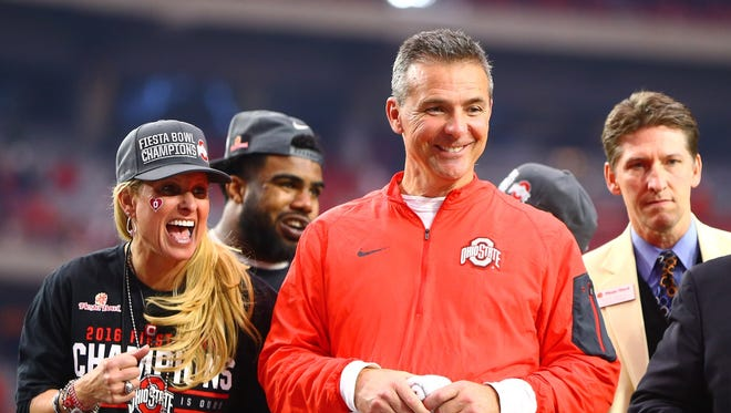 Ohio State coach Urban Meyer, right, and Shelley Meyer, left.