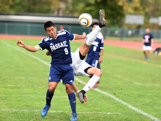 Passaic Valley # 17 Santiago Hernandez clears the ball