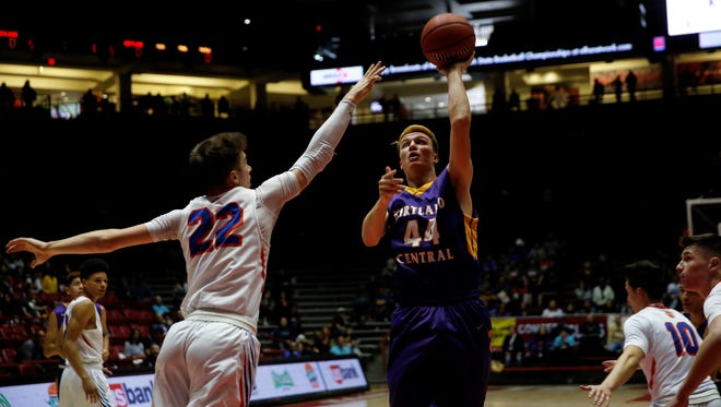 Kirtland Central's Bryson Dowdy pivots forward for a layup against Los Lunas defender Zanen Zeller during the 5A state quarterfinals on March 7 in Albuquerque. Dowdy made 5A's First All-State boys team.
