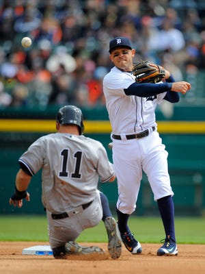 Ian Kinsler forces out Brett Gardner and turns a double play in the first inning Friday.