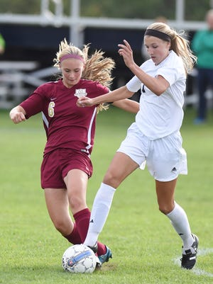 John Jay's Erin Theiller, right, and Arlington's Rachel Moran battle for control of the ball during a Sept. 22, 2015 game at John Jay.
