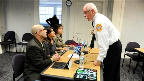 Sandy Hook Advisory Commission member and Norwalk Fire Chief, Denis McCarthy, right, speaks with , Jeremy Richman, left, and his wife Jennifer Hensel, second from left, parents of Sandy Hook Elementary school shooting victim Avielle Richman, and Nelba Marquez-Greene, second from right, mother of victim Ana Marquez-Greene before a meeting with the commission Nov. 14, in Newtown, Conn. The parents made presentations on ways to better address mental health, school safety and gun violence prevention.