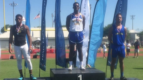 Joshua Seals stands at the podium after winning the 100-meter dash in last week's AHSAA Class 4A state meet in Gulf Shores.