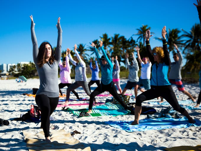 Lauren Fox, director of Donation Yoga Naples, leads