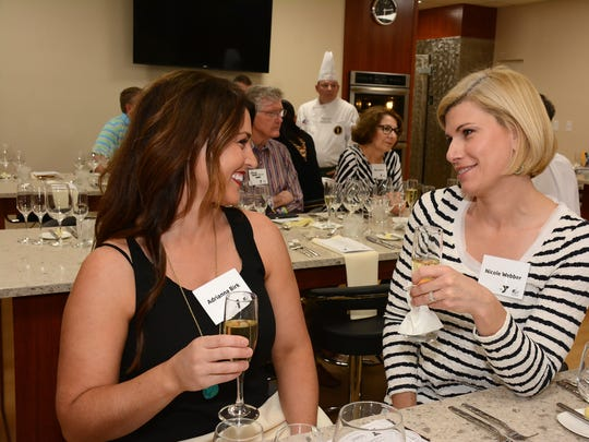 Guests Adriana Birk and Nicole Weber enjoy their night out at the first of the YMCA's Beyond the Plate dinners.