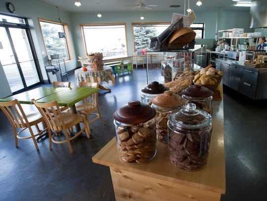 The dining room is seen of East Village Baker. The