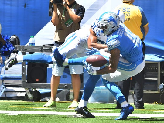 Detroit Lions rookie wide receiver Kenny Golladay pulls in a one-handed touchdown reception under the Indianapolis Colts' Quincy Wilson in the first quarter Sunday.