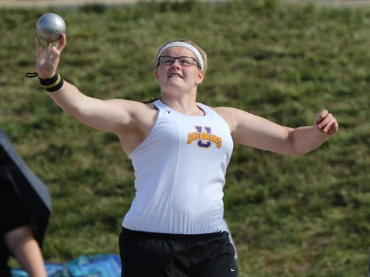 Unioto's Autumn Mohan competes in shot put during the