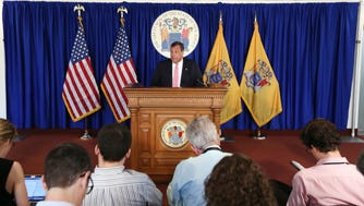 Gov. Chris Christie holds a press conference in Trenton on Wednesday announcing $15.5 million in fines against Horizon Blue Cross Blue Shield.