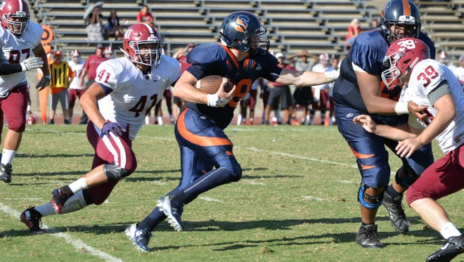COS quarterback Thomas Wilson rumbles for yardage on a keeper in the Giants' game against Sierra College at Giant Chevrolet-Cadillac Mineral King Bowl.