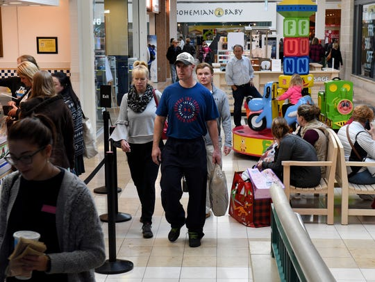 Black Friday shoppers at West Town Mall Friday, Nov.