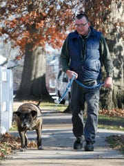 Pete Buchmann outside his Hampton Walk apartment with Buster in 2015.
