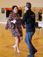 Julia Lewis practices her dance moves with her partner