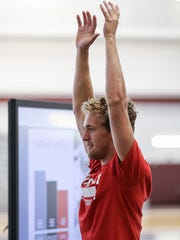 Sam Sedgwick, a Roncalli senior, performs a vertical jump during a free Sports Science Combine for Indiana high school football players at Lawrence Central High School, Lawrence, Ind., Wednesday, July 26, 2017. The combine evaluated players physically and mentally, offering individualized assessments and areas to grow based on physical and behavioral science.
