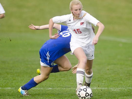 Champlain Valley's Sierra Morton (15) dribbles past
