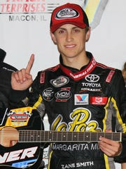 Zane Smith shows off his guitar trophy after winning the Music City 200 ARCA Series Race Saturday night.