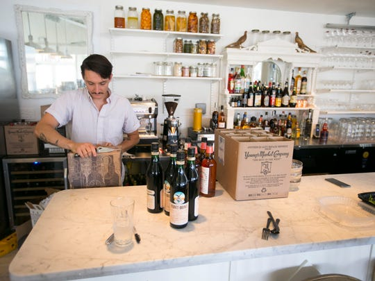 Bartender Blaise Faber, prepares the bar in Chris Bianco's