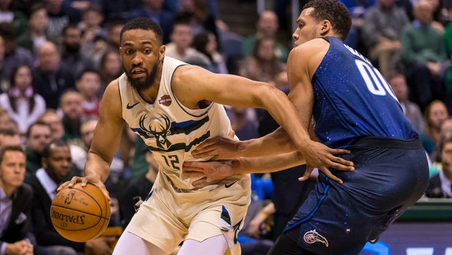 Bucks forward Jabari Parker gets a step on Magic forward Aaron Gordon on a drive to the basket during the third quarter.