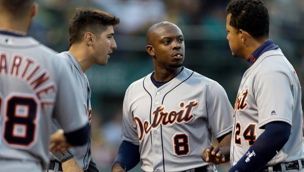 Tigers leftfielder Justin Upton (8) is congratulated