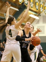 Western Mennonite's Emma Gibb goes up for a shot under