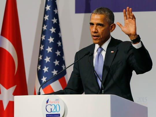U.S. President Barack Obama gestures to journalists following a news conference at the end of the G-20 summit in Antalya, Turkey, Monday, Nov. 16, 2015. The Paris terror attacks have sparked widespread calls from congressional Republicans to end or limit U.S. refugee admissions from Syria, with some threatening to use critical spending legislation as leverage weeks from a must-pass deadline. That could allow Republicans to block Obama's goal of bringing 10,000 more Syrian refugees to the U.S. during this budget year.