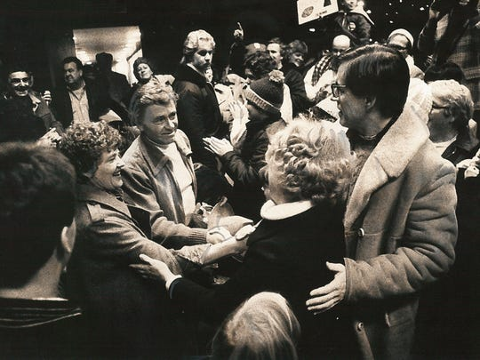 Tubby Raymond and his wife, Sue, are congratulated by Gov. Pete du Pont and his wife, Elise, as the team arrived at Philadelphia airport on Dec. 8, 1979.