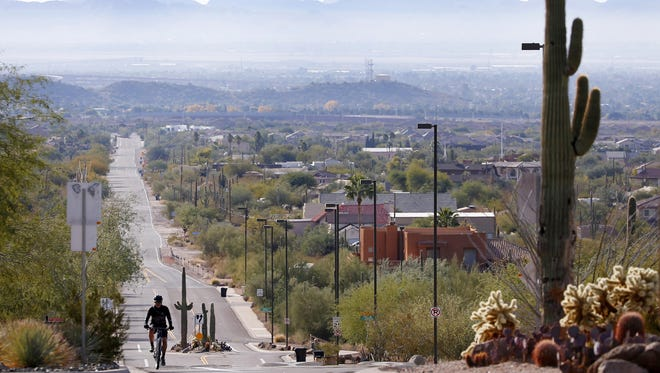 Smog can be seen lingering around the San Tan Mountains from Hawes and Thomas in Mesa on Jan. 1, 2018.