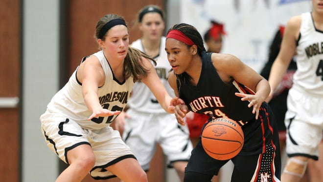 North Central's Ajanae' Thomas is guarded by Noblesville's Emily Kiser, Feb. 13, 2015.