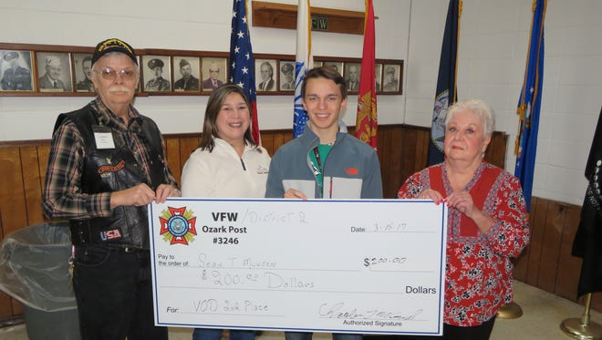 Ozark Post 3246 Veterans of Foreign Wars presented a check for $200 to the Arkansas District 2 VFW Second place winner Sean Munson for his patriotic assay in the Voice of Democracy competition. Shown are Post Commander, Charles Wensel, from left, Danielle Sanders mother of winner, Sean Munson, winner and Auxiliary President, Kathy Sisney. The Voice of Democracy was initiated by the National Veterans of Foreign Wars in 1947 as a way to promote patriotism in High School students. Voice of Democracy has been the VFW's scholarship program. Each year, almost 40,000 high school students compete for more than $2 million in scholarships and incentives. Students compete by writing and recording an audio essay on an annual patriotic theme with a five minute limit.