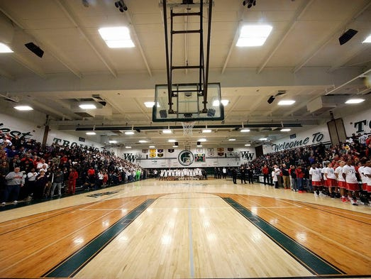 The Wauwatosa West (center) and East (right) Varsity